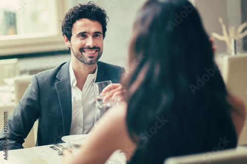 Leinwandbild Motiv Cheerful couple in a restaurant