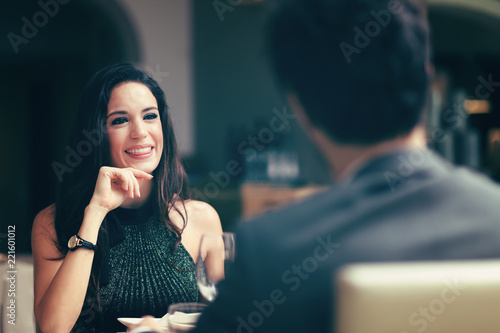 Cheerful couple in a restaurant - 221601012