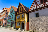 Colorful houses in the medieval town of Rothenburg ob der Tauber in Bavaria, Germany - 221604071