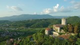 Aerial footage of medieval castle on a hill above Vipava valley - 221612678