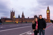 Couple of middle-aged tourists in London during the sunset with the House of Parliament in the background