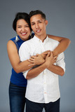 Hugging young couple - 221632602