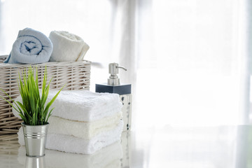 white towels on white table with copy space on bright room background © coolhand1180