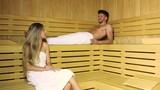 Couple talking in a sauna - 221636428