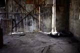 corrugated metal door and wall of old repair garage - 221638437