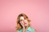 facial expression. low mood and emotion. bored unimpressed disinterested woman looking up. young beautiful blond girl portrait on pink background. - 221647054