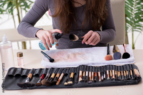 Make-up artist preparing brushes for work