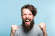 yes success and achievement. happy overexcited enthusiastic exhilarated guy making a win gesture and screaming. thrilled man portrait on blue background. - 221647478