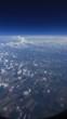 Вид из окна самолёта. Облака. Земля. - 221652255