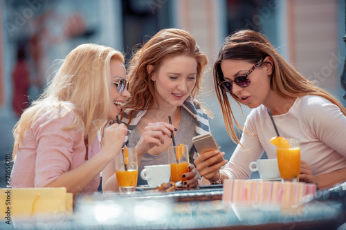 Friends having a great time in cafe - 221656218