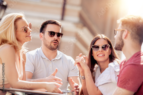 Naklejka Friends having a great time in cafe
