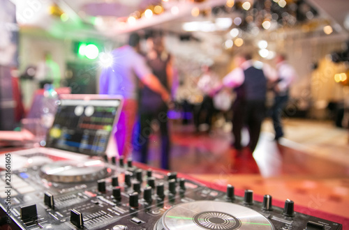 The disco, Banquet, people blurred background dancing. Dj panel	 - 221661605