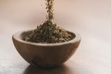 dried provence herbs in wood bowl for seasoning on table - 221664448