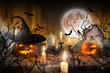 Leinwanddruck Bild - Halloween pumpkins on wooden planks.