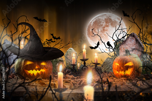 Halloween pumpkins on wooden planks. - 221667080