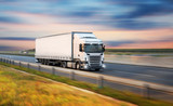 Truck with container on road, cargo transportation concept. - 221667826