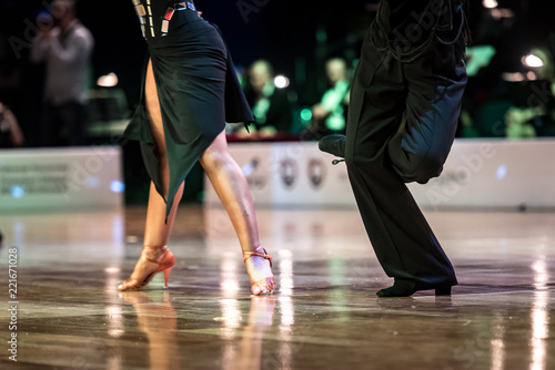 Beautiful womanish and masculine legs in active ballroom dance, indoors - 221671028