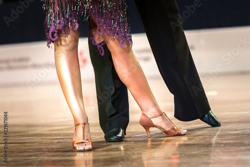 Legs of young dancers on the dance floor - 221671044