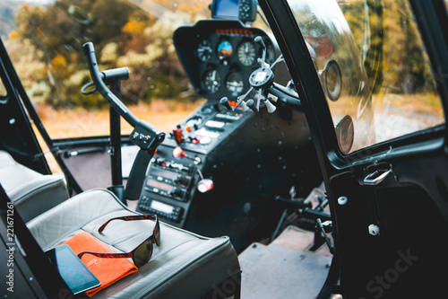 Fototapeta Helicopter cockpit detail in the mountains