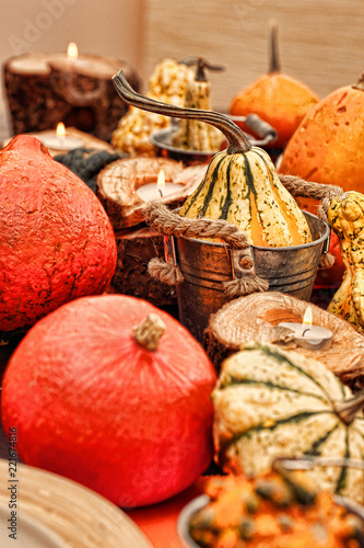 Autumn pumpkins and candles with empty space for text - 221674816
