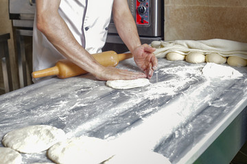 Man prepearing bread dough