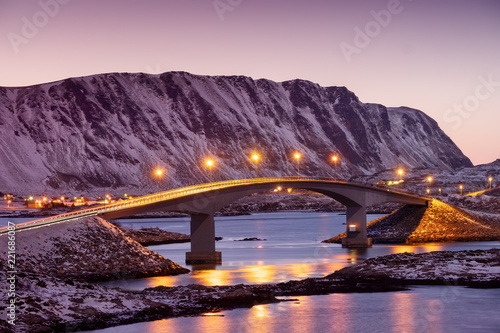 Bridge and reflection on the water surface. Natural landscape in the Lofoten islands, Norway. Architecture and landscape.