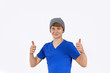 portrait of teenage boy with cap showing thumbs up sign