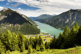 The beautiful Lake Achen. The highest lake in the Austrian Tyrol and lies north of Jenback. Has a maximum depth of 133m and rarely does the temperature rise above 20C, but ideal for windsurfing. - 221696858