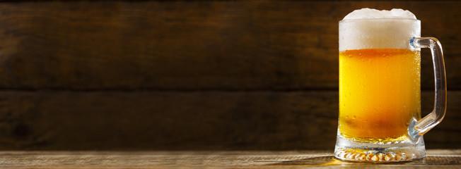 mug of beer on wooden table © Nitr