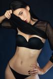 Beautiful and slender girl posing in lingerie