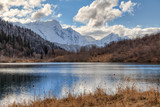 Kardyvach mountain lake with sky reflections. Scenic dramatic autumn sunset landscape. Sochi, Russia, Caucasus mountains - 221706829