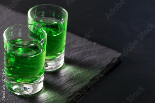 Fototapeta samoprzylepna Two glasses of strong absinthe