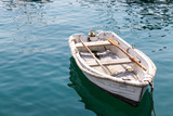 white wooden boat on blue calm water in lake - 221709053