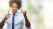 Afro american man holding credit card over isolated background annoyed and frustrated shouting with anger, crazy and yelling with raised hand, anger concept