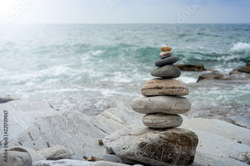 Balanced rocks on the beach. Relaxation concept - 221709867