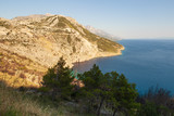 View of the shores of the Adriatic Sea and the Biokovo Mountains in the background in Croatia - 221712813