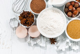 ingredients for baking and spices on white background, top view closeup - 221712859