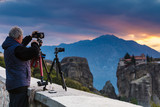 Man take photo from Meteora monastery - 221714288