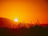 Sunrise over mountain hill - 221725472