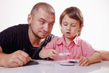 Father having fun with little daughter and  playing board game. - 221727405