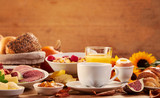 Side view of multiple platters of food and drink - 221729442