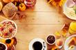 Leinwandbild Motiv Seasonal autumn breakfast food frame on wood