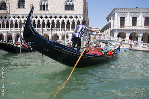 VENICE, ITALY - AUGUST 29, 2018: Traditional narrow canal street with gondolas and old houses in Venice, Italy.  - 221731004