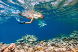 Family mother and daughter snorkeling - 221740064