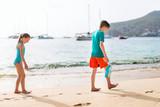 Kids having fun at beach - 221740818