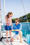 Family on board of sailing yacht - 221740857