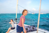Family on board of sailing yacht - 221740895