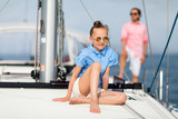Family on board of sailing yacht - 221741015