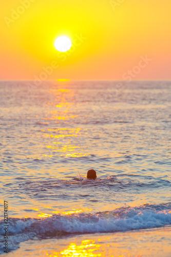 Leinwandbild Motiv the boy is resting on the sea