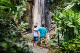 Family at waterfall - 221741875